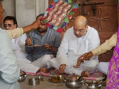 In June, BJP President Amit Shah shared a meal with a Dalit family in Varanasi's Jogiyapur village. In August he had to cancel a rally in Agra following the 'Una Chalo!' march. (Photo: PTI)