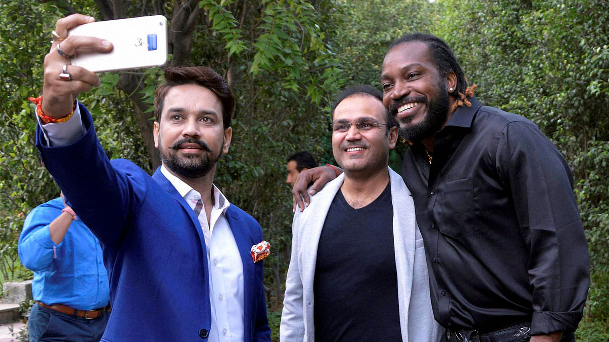 BCCI president Anurag Thakur (L), Virender Sehwag (M) and Chris Gayle (R) at Chris Gayle's book launch in New Delhi. (Photo: PTI)