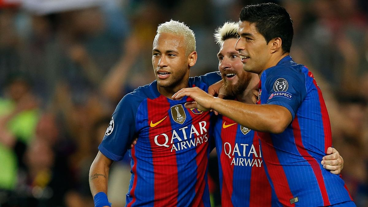 Barcelona's Lionel Messi (C) celebrates with teammates Luis Suarez (R) and Neymar after scoring his side's fifth goal during a Champions League match with Celtic in Barcelona, Spain on Tuesday. (Photo: AP)