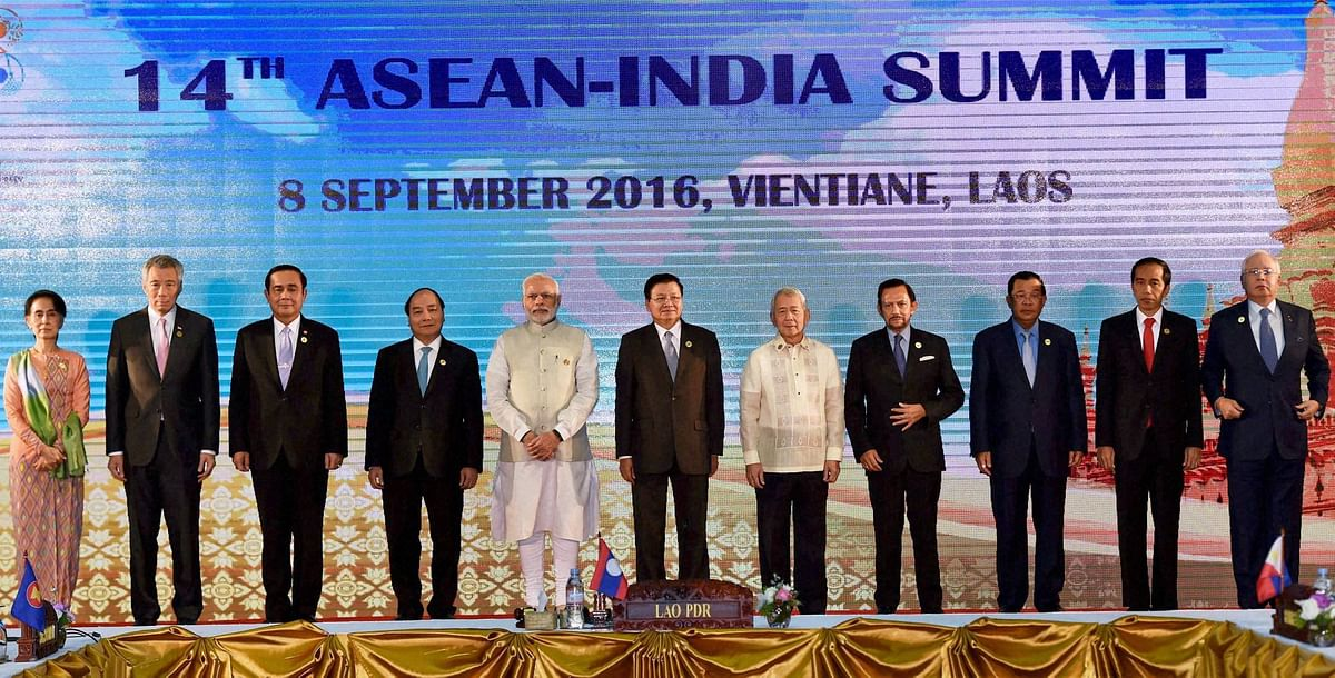 Prime Minister Narendra Modi posing for a group photo at the 14 ASEAN summit in Laos. (Photo: PTI)