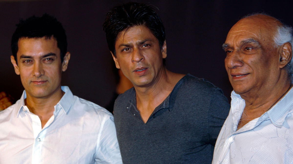 Aamir Khan, Shah Rukh Khan and filmmaker Yash Chopra during a news conference in Mumbai April 7, 2009. (Photo: Reuters)