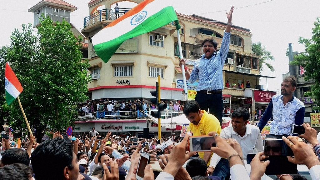 Hardik Patel, convener of the Patidar Anamat Andolan Samiti, leading  an agitation in Gujarat. (Photo: PTI)