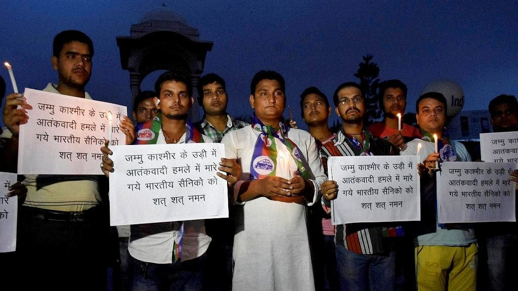 Lok Janshakti party activists during a candle light vigil to pray for soldiers killed in the terror attack in Uri near the Line of Control, in Patna on Sunday. (Photo: PTI)