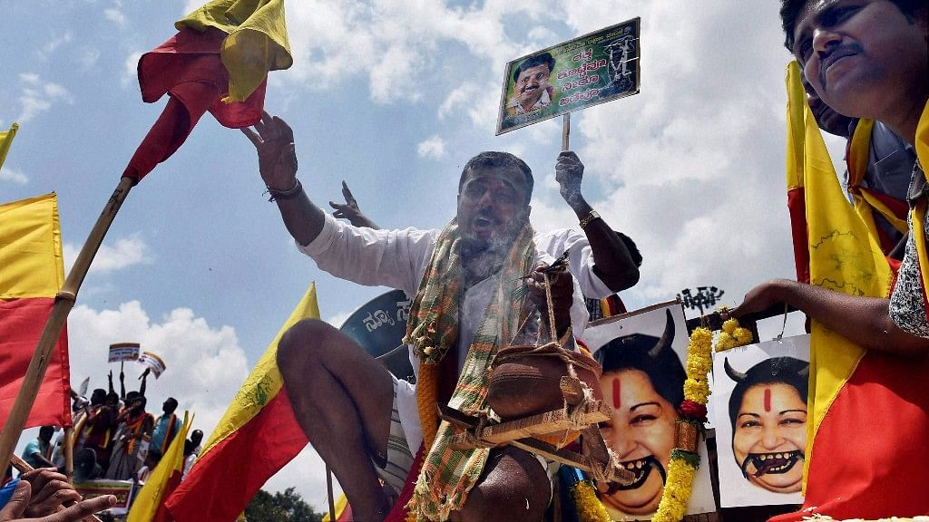 Protesters destroy posters of Tamil Nadu Chief Minister J Jayalalithaa. (Photo: PTI)