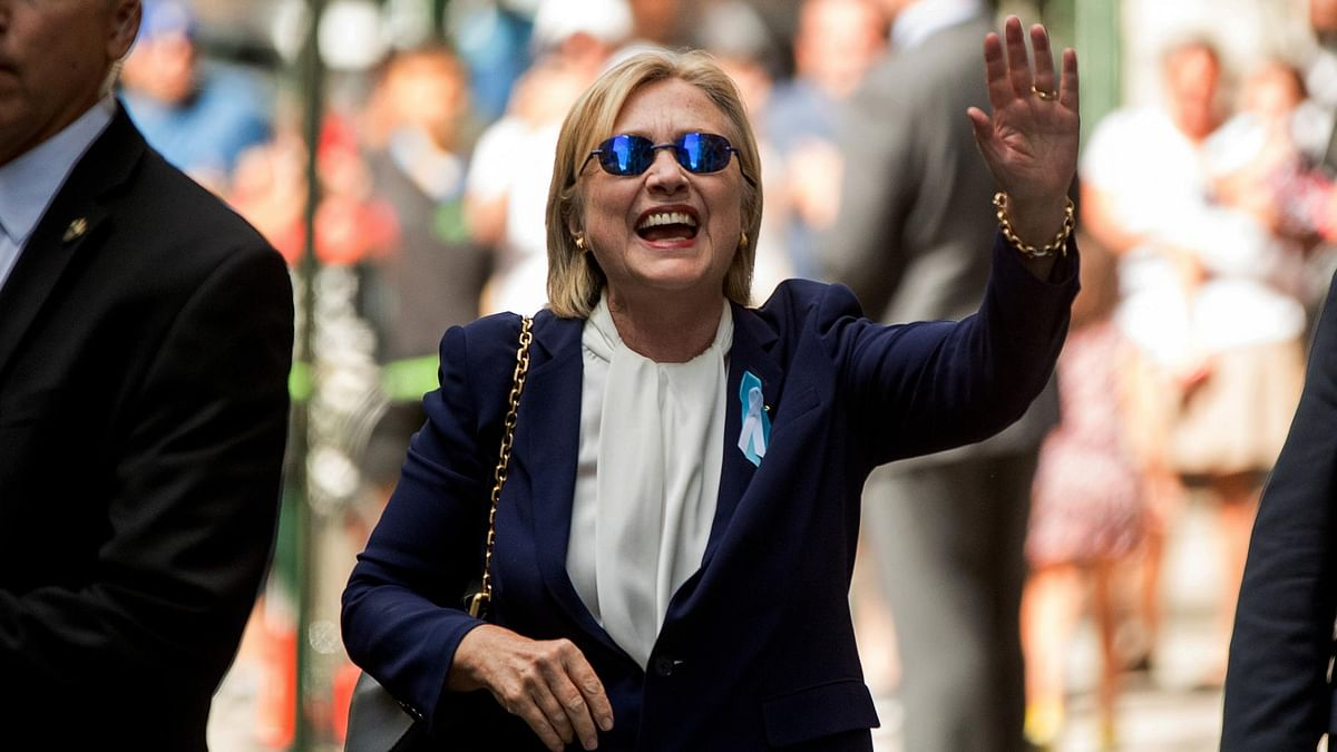 Democratic presidential candidate Hillary Clinton waves after leaving an apartment building on Sunday. (Photo: AP)