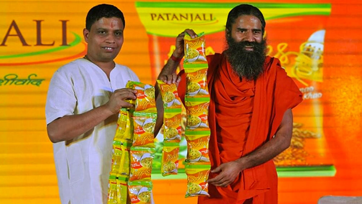 """Patanjali Ayurved's CEO with Baba Ramdev. (Photo Courtesy: Twitter/<a href=""""https://twitter.com/just2_read/status/775637245579714560"""">@Just_2Read</a>)"""
