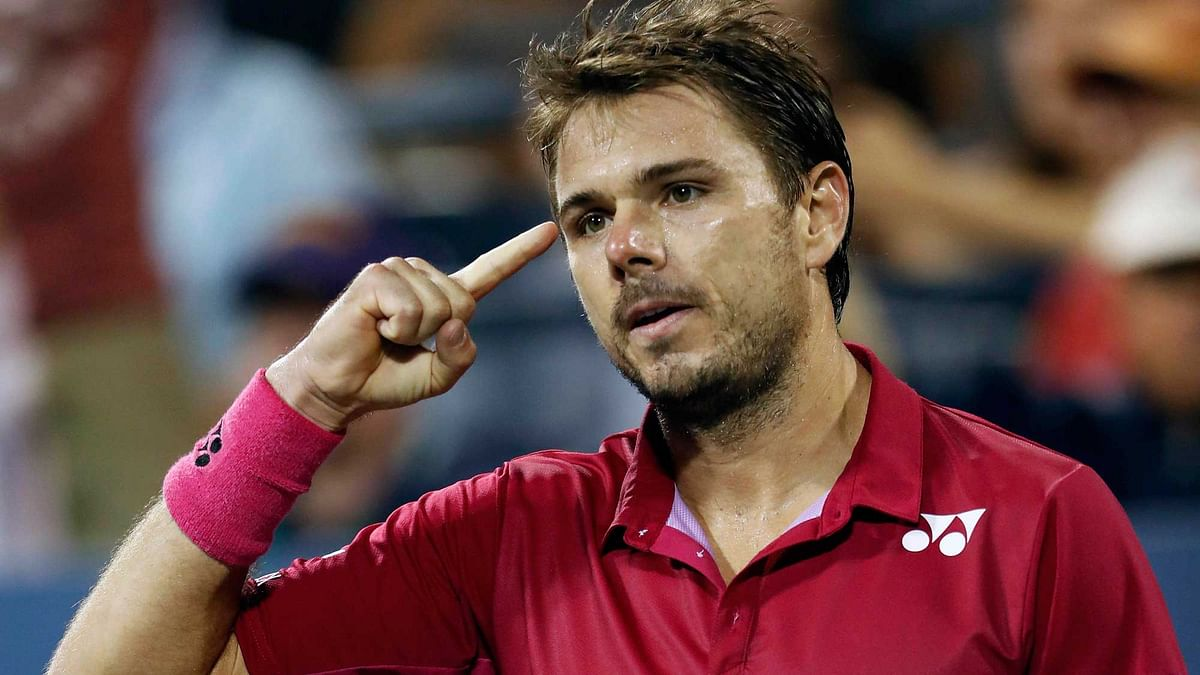 Stan Wawrinka, of Switzerland, celebrates after defeating  Daniel Evans. (Photo: AP)