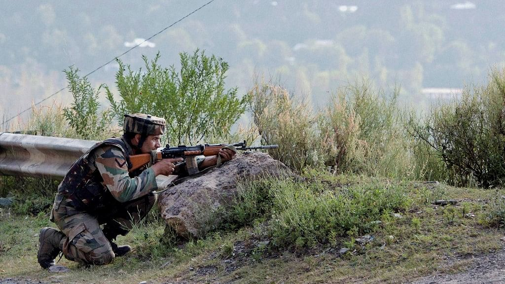 An Army soldier takes position near Army Brigade camp during a terror attack in Uri, Jammu and Kashmir on Sunday. (Photo: PTI)