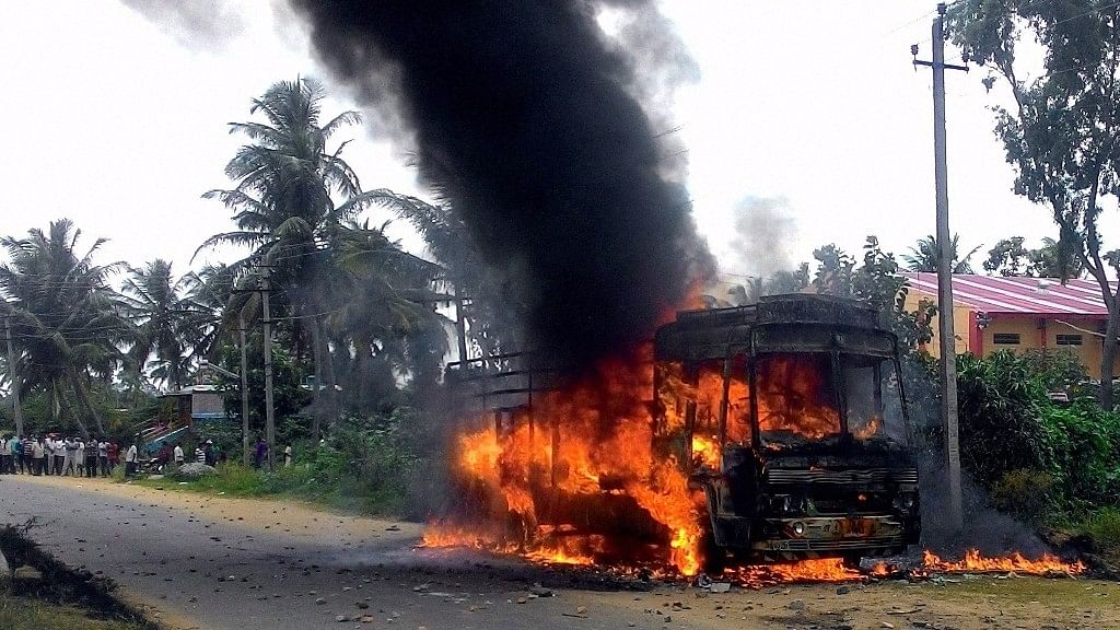 A vehicle in flames after it was torched by Pro-Kannada activists. (Photo: PTI)