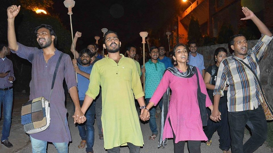 """Torchlight procession being led by students belonging to the Students' Federation of India, 5 September 2016. (Photo Courtesy: SFI JNU/<a href=""""https://www.facebook.com/sfijnuunit/photos/?tab=album&amp;album_id=1213047132050755"""">Facebook</a>)"""