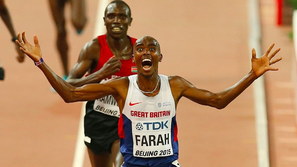 Britain's Mo Farah celebrates after winning the gold medal in the men's 10,000 m final at the World Athletics Championships. (Photo: AP)