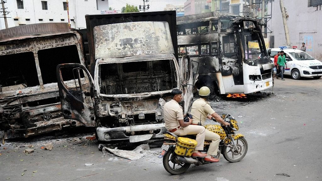 Charred remains of the vehicles in Bengaluru on Tuesday, a day after they were torched by pro-Kannada activists during violent protests over Cauvery water dispute. (Photo: PTI)