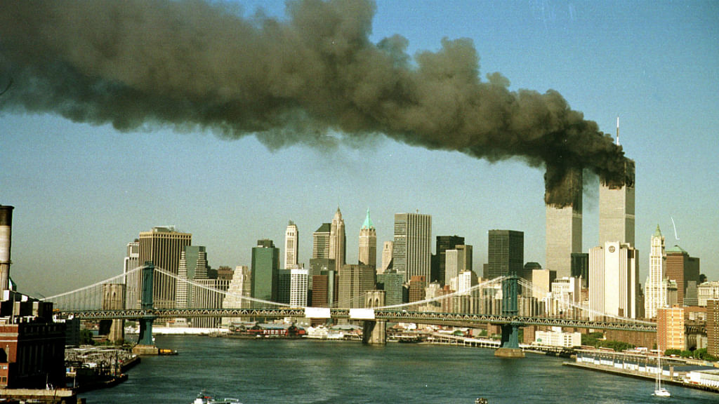 The towers of New York's World Trade Centre pour smoke shortly after being struck by hijacked commercial aircraft on 11 September, 2001. (Photo: Reuters)