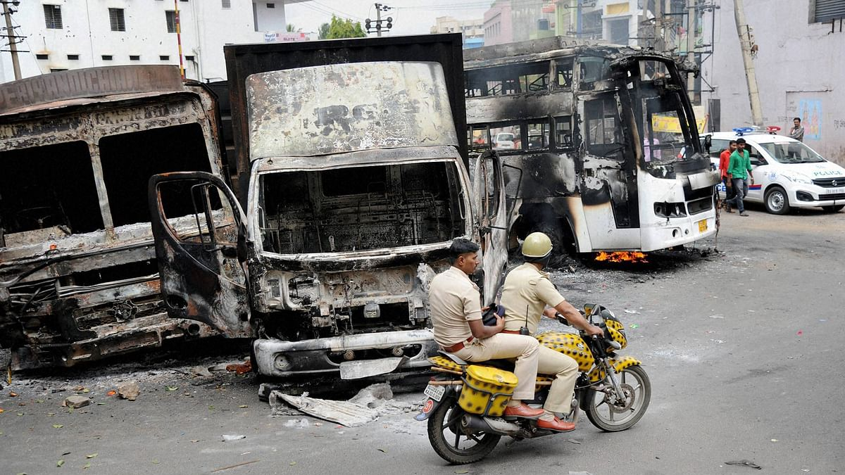 Charred remains of the vehicles in Bengaluru on Tuesday, a day after they were torched by pro-Kannada activists during their violent protests over Cauvery water row. (Photo: PTI)