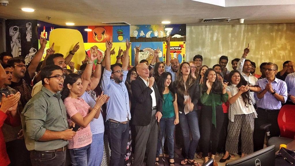 Team Quint celebrates in the newsroom.