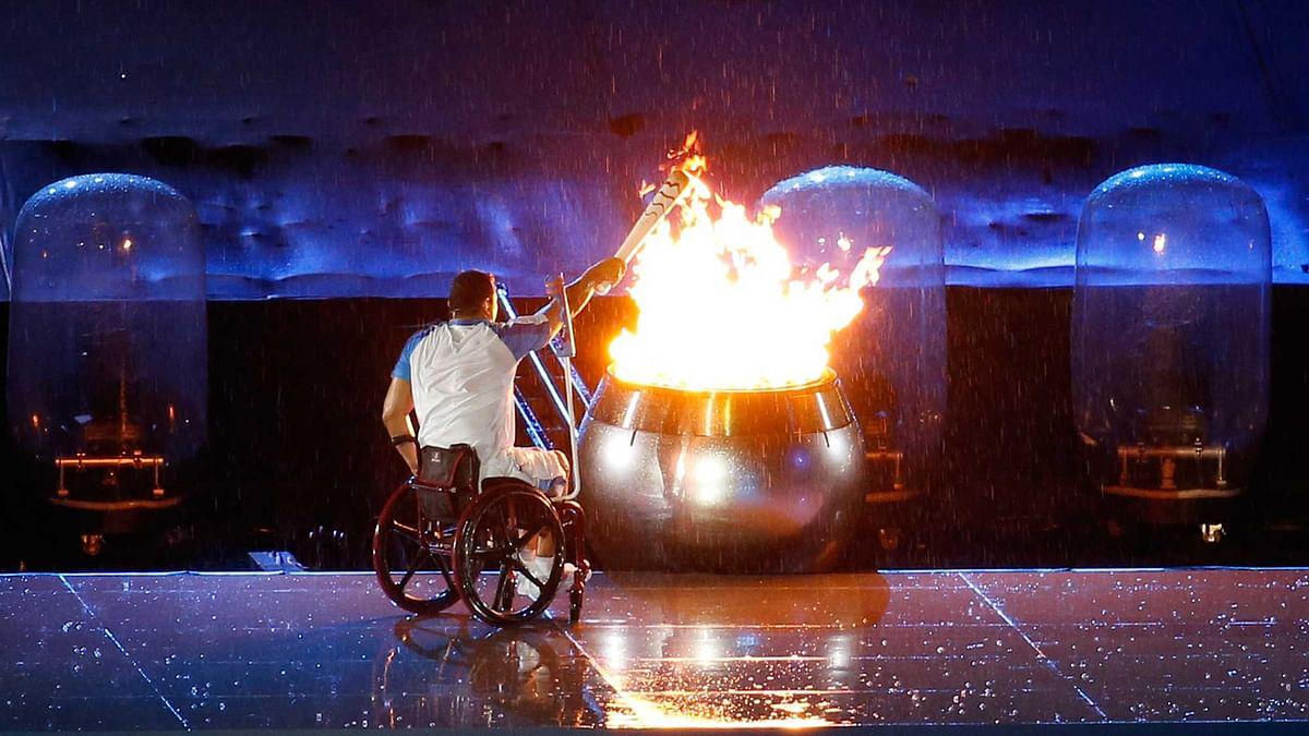 Brazilian athlete Clodoaldo da Silva lights the olympic flame during the opening ceremony of the Rio 2016 Paralympic Games at Maracana Stadium. (Photo: AP)
