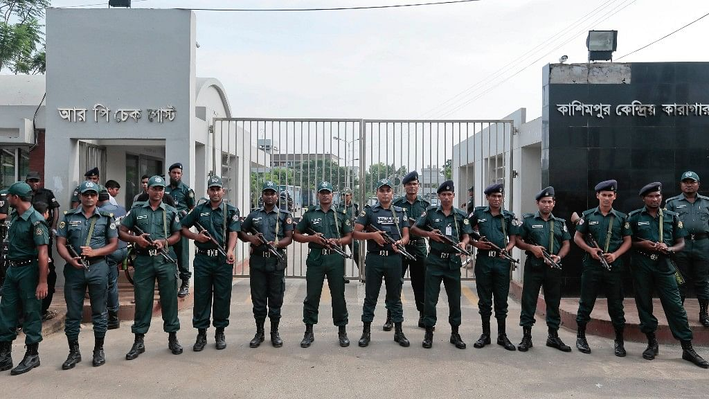 Bangladeshi security personnel stand guard in front of Kashimpur Central Jail where Mir Quashem Ali, a senior leader of the main Islamist party Jamaat-e-Islami, was being held. (Photo: AP)