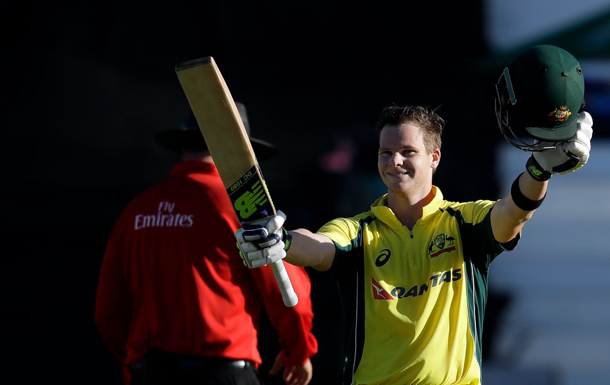 Australian captain Steven Smith celebrates after scoring a hundred against South Africa in the third one day international at Durban. (Photo: AP)
