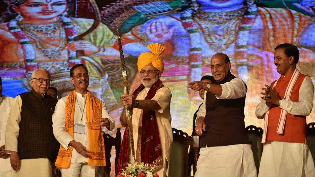 Prime Minister Narendra Modi being welcomed on stage at the Aishbagh Ram Leela in Lucknow. (Photo Courtesy: Press Information Bureau)