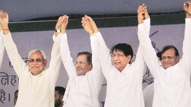 Nitish Kumar, Sharad Yadav and Ajit Singh at a rally in Baghpat on Tuesday. (File Photo: PTI)