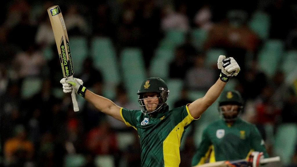 David Miller raises his bat after scoring a hundred against Australia in the third One Dayer of the series at Durban. (Photo: PTI)