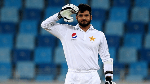 """Azhar Ali celebrates after bringing up his double hundred in the first test match against West Indies in Dubai. (Photo Courtesy: Twitter/<a href=""""https://twitter.com/ICC"""">@ICC</a>)"""