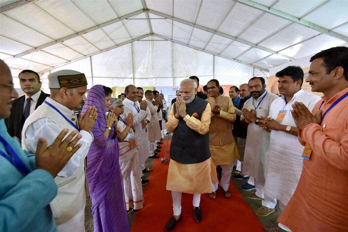 Narendra Modi with Shivraj Singh Chauhan in Bhopal on Friday. (Photo: PTI)