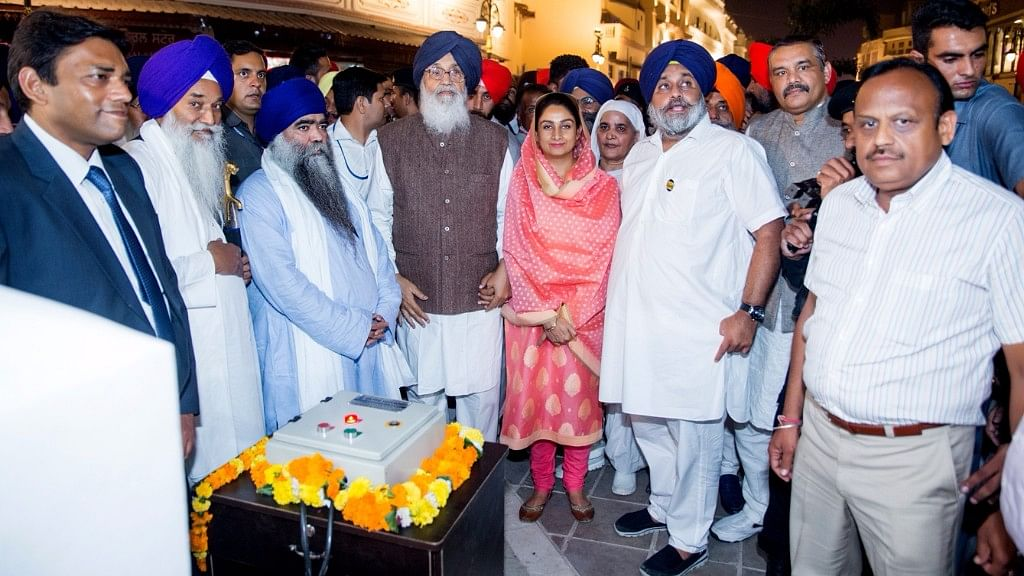 Punjab Chief Minister Parkash Singh Badal and Deputy Chief Minister Sukhbir Singh Badal   during the inauguration of the Amritsar Beautification Project on  25 October 2016. (Photo: IANS)