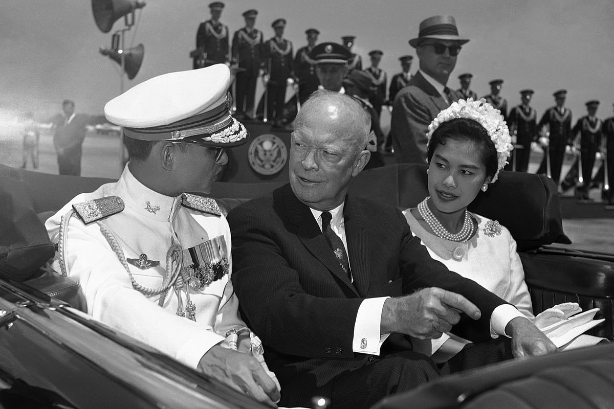 In this file photo, US President Dwight Eisenhower, center, is seated between Thailand's King Bhumibol Adulyadej, left, and Queen Sirikit for a motorcade drive. (Photo: AP)