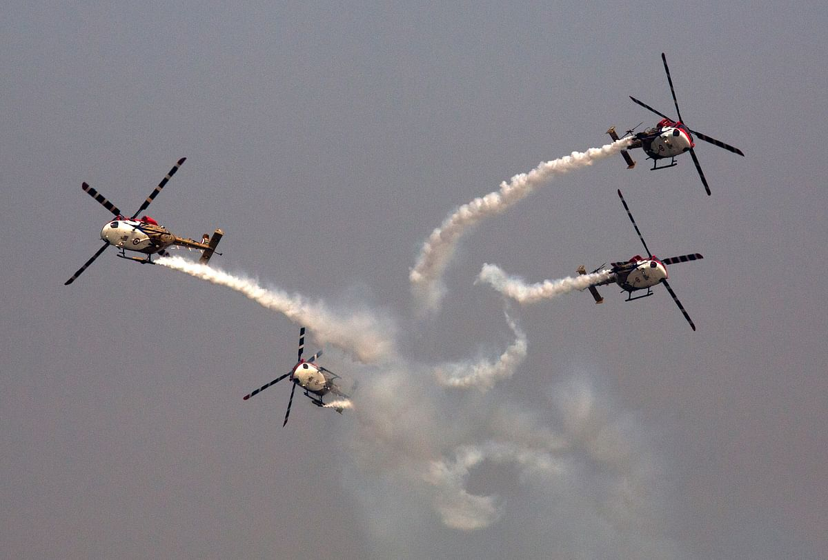 The 'Sarang' helicopter display team shows its skills during Air Force Day celebrations at the Hindon air base near New Delhi. Air Force Day is celebrated to mark the establishment of the Indian Air Force in 1932.  (Photo: AP Photo/Manish Swarup)