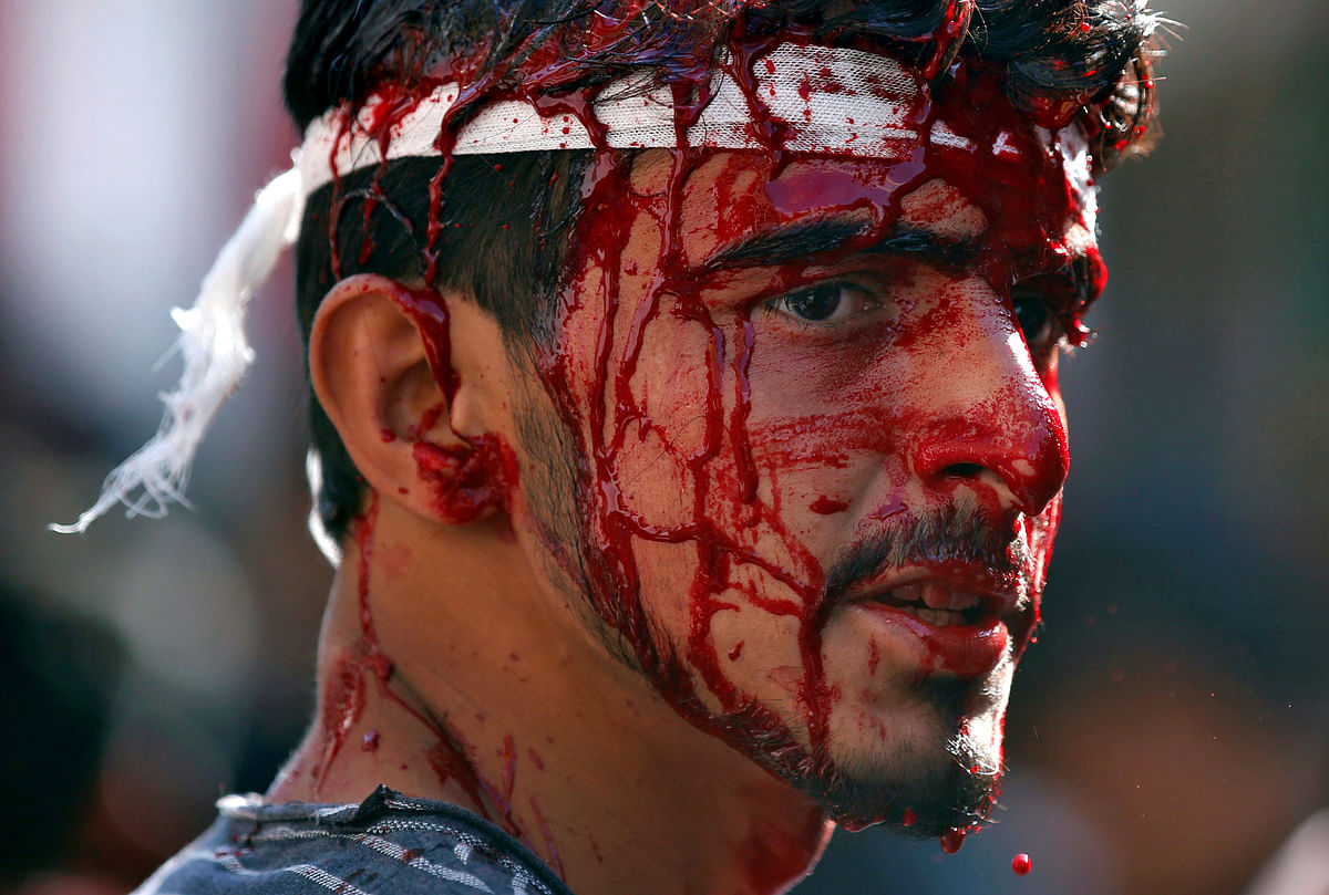 A Kashmiri Shia Muslim bleeds after he flagellated himself during a Muharram procession in Srinagar. (Photo: Reuters/Danish Ismail)