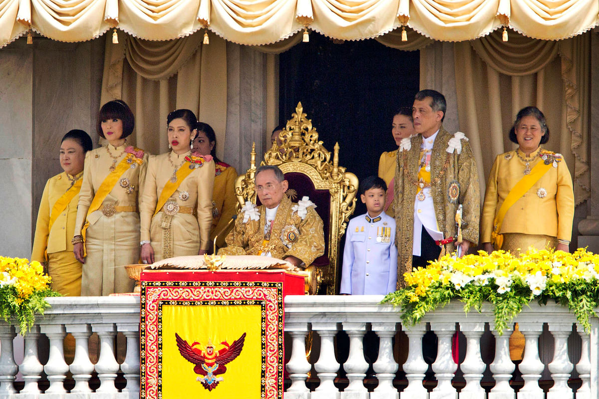 File photo of Thailand's King Bhumibol Adulyadej, seated center, and his family members. (Photo: AP)