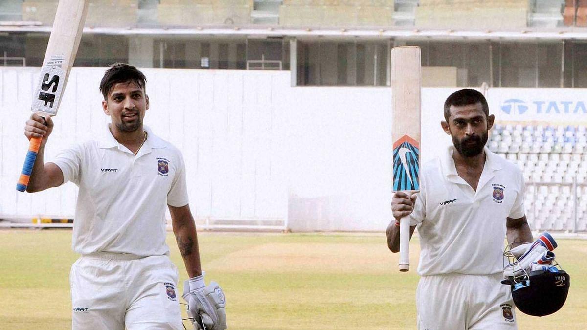 Skipper Swapnil Gagale and Ankit Bawne of Maharashtra after their record partnership 594 runs against Delhi at the Ranji Trophy match. (Photo: PTI)