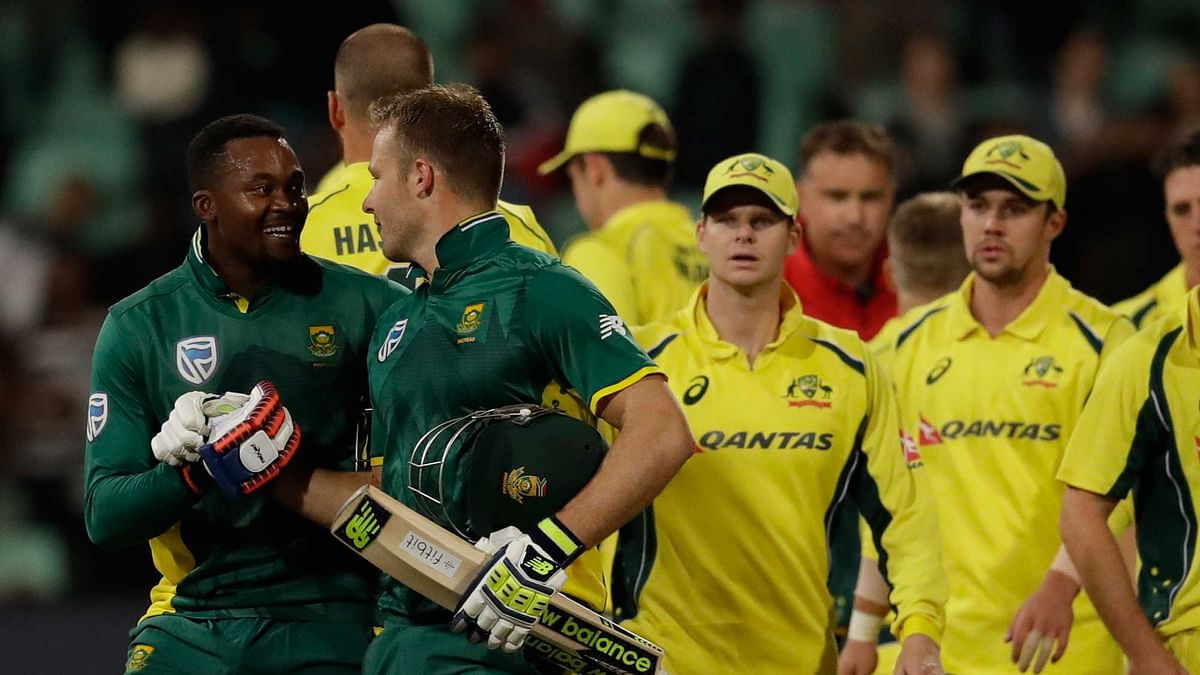 South Africa's batsman Andile Phehlukwayo, left, with teammate David Miller, leaves the field after scoring the winning runs. (Photo: AP)