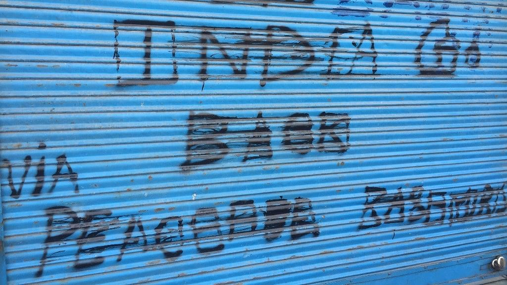 Graffiti outside a shop in Srinagar; the Valley continues to remain tense after Burhan Wani's killing on 8 July, 2016. (Photo: Parth MN/ <b>The Quint</b>)