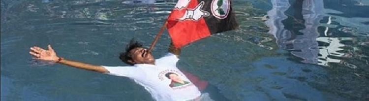An MLA from AIADMK held a party flag and floated for Amma's long life. (Photo Courtesy: <i>The News Minute</i>)
