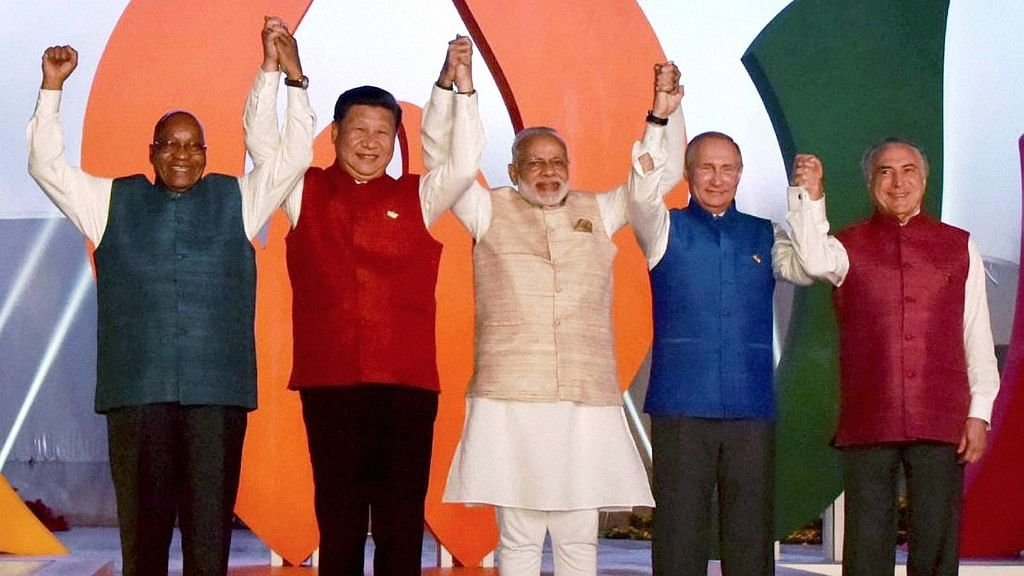 Prime Minister Narendra Modi with other BRICS leaders wearing ethnic jackets before the informal dinner on Saturday, 15 October 2016. (Photo: PTI)