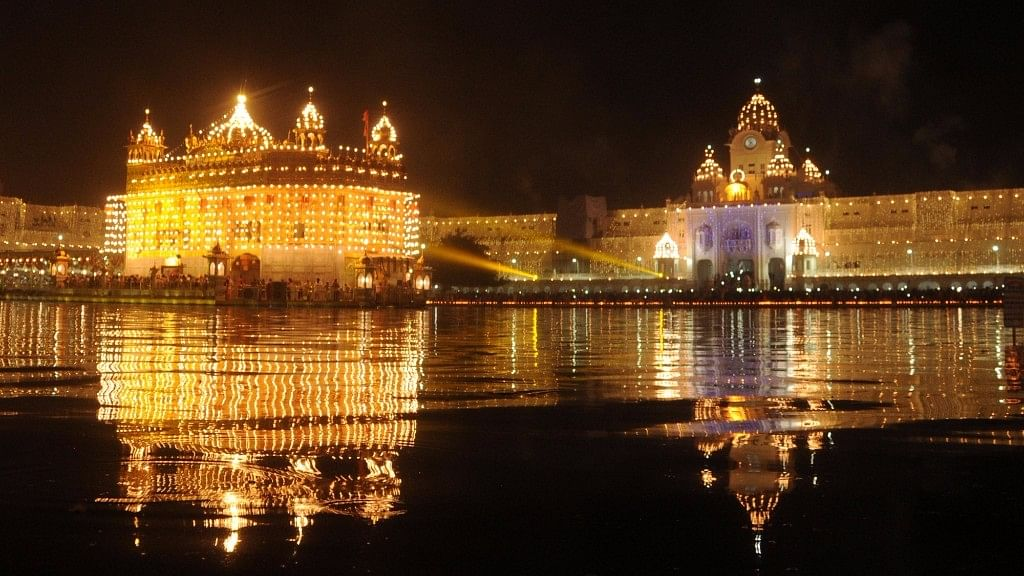 A view of spectacularly lit Golden Temple on the birth anniversary of the fourth Sikh Guru Ramdas, in Amritsar on  17 October 2016. (Photo: IANS)