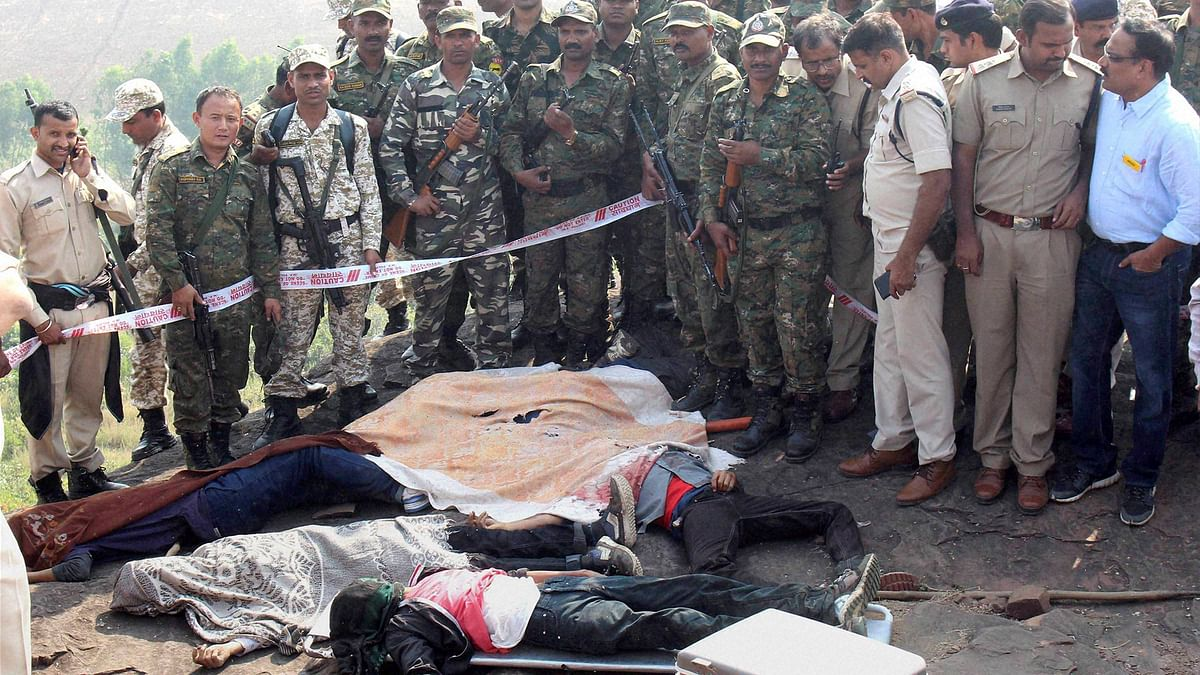 File photo of police at the encounter site at the hillocks of Acharpura village after the STF killed 8 Students of Islamic Movement of India (SIMI) activists who escaped Central Jail killing a security guard in Bhopal on Monday.