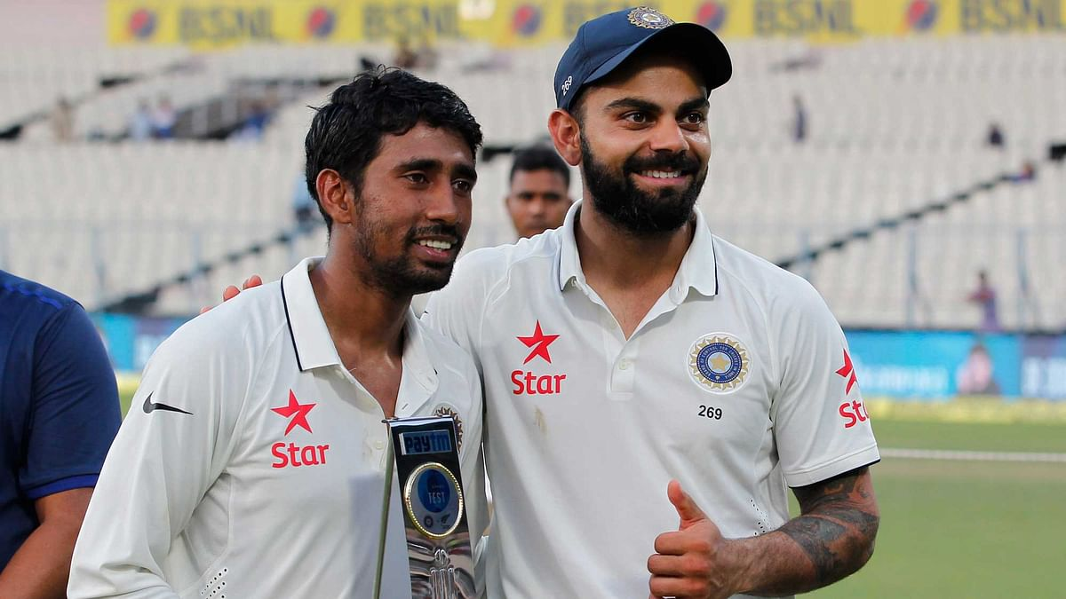 File picture of Wriddhiman Saha with skipper Virat Kohli.