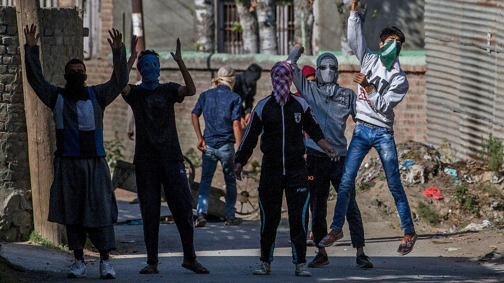 Masked Kashmiri protesters shout pro-freedom slogans during a protest in Srinagar, India Controlled Kashmir. (Photo: AP)