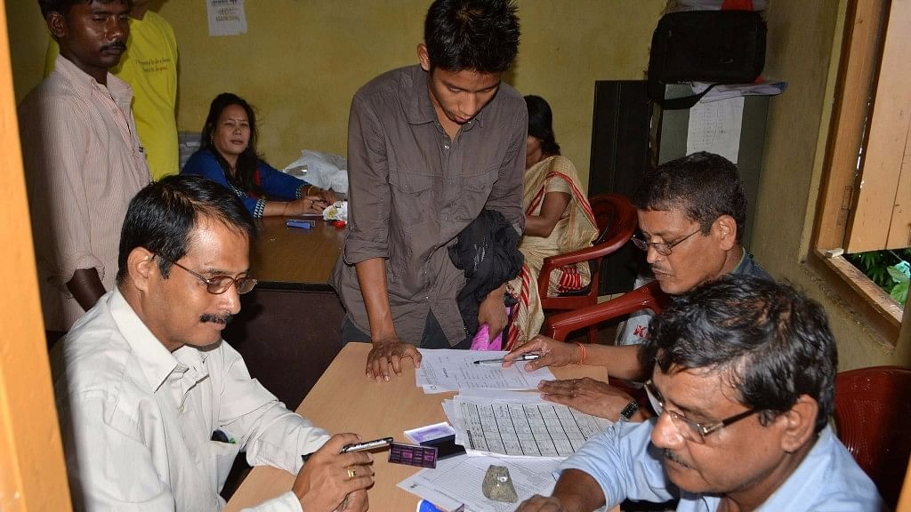 People submit duly filled in National Register of Citizens (NRC) forms on the last day of submission in Guwahati, on 31 August 2015. (Photo: IANS)