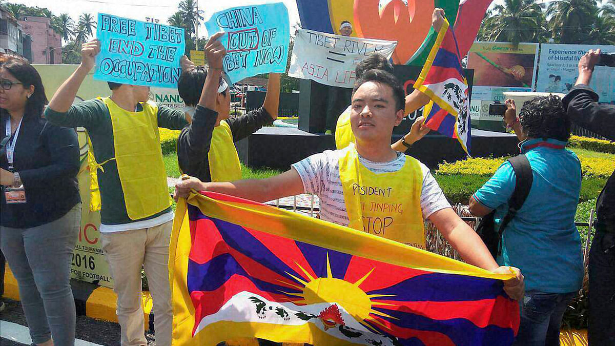 Tibetans display placards during protest against China demanding Tibet be freed, at Margao, Goa on Saturday.