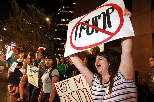 People on Broadway on 9 November 2016, in downtown San Diego, during a protest in opposition of Donald Trump's presidential election victory. (Photo: AP)