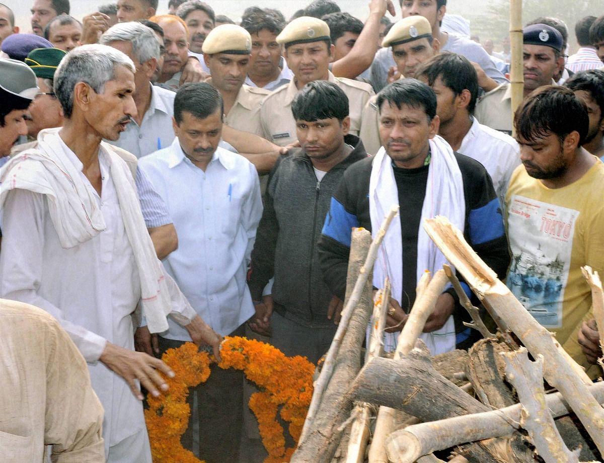 Delhi CM Kejriwal attending the funeral of Ram Kishan Grewal on Thursday. (Photo: PTI)