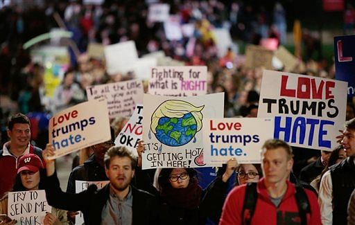 A few thousand protesters march through Library Mall from UW-Madison's Bascom Hall to the State Capitol, protesting President-elect Donald Trump on 10 Nov 2016, in Madison, Wisconsin. (Photo: AP)