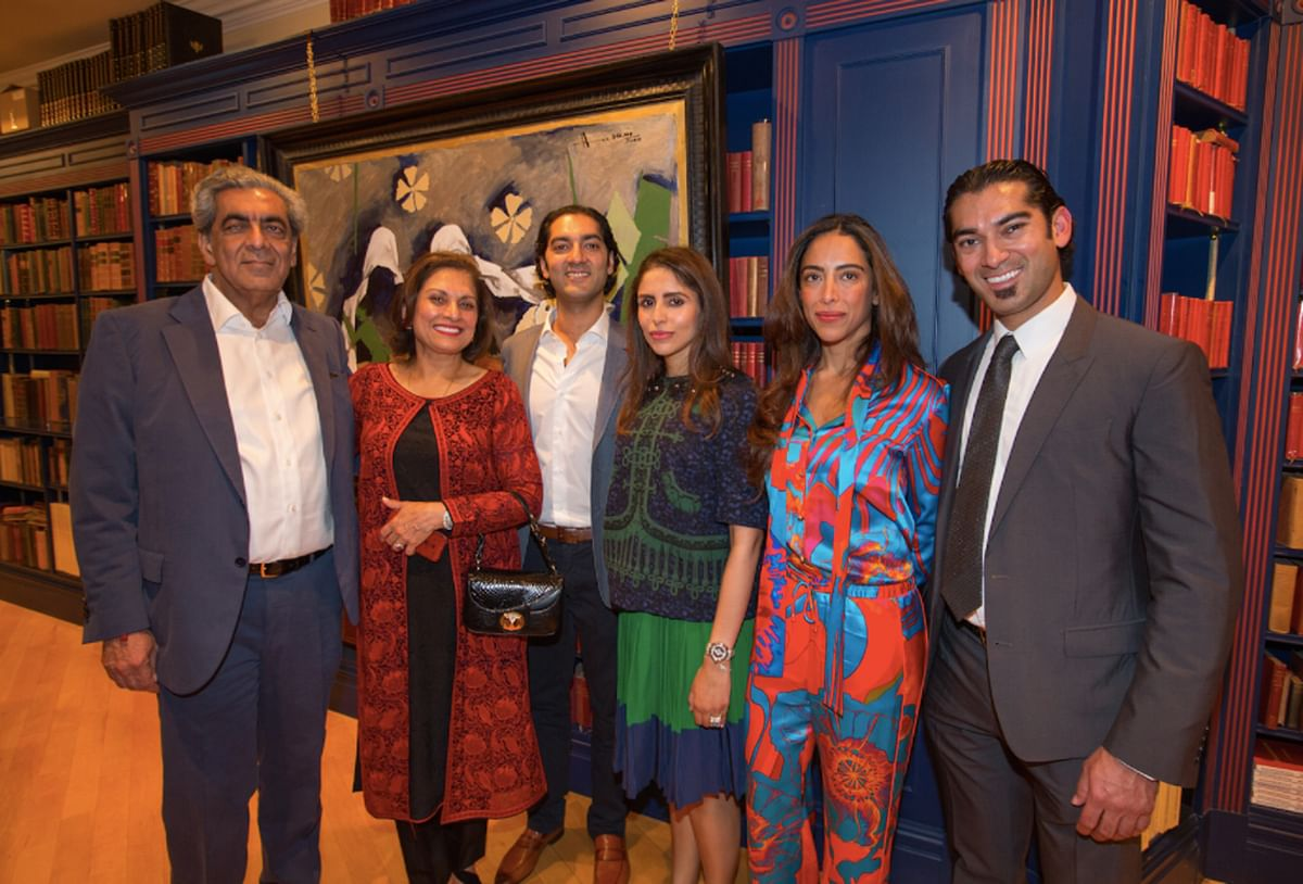 "Sudhir Choudhrie (left) with his family. (Photo courtesy: <a href=""https://www.asian-voice.com/News/UK/London/MF-Husain-The-Journey-of-a-Legend2"">Asian Voice</a>)"