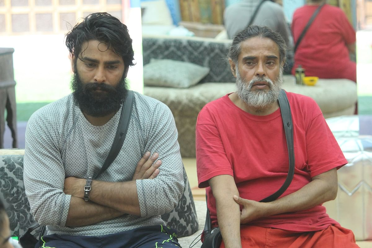 Manveer and Om Swami look serious in the <i>Bigg Boss </i>house.<i> </i>(Photo courtesy: Colors TV)