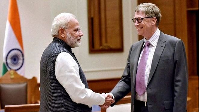 Prime Minister Narendra Modi greets Microsoft founder Bill Gates during the NITI Aayog's 'Transforming India' event in New Delhi. (File Photo)