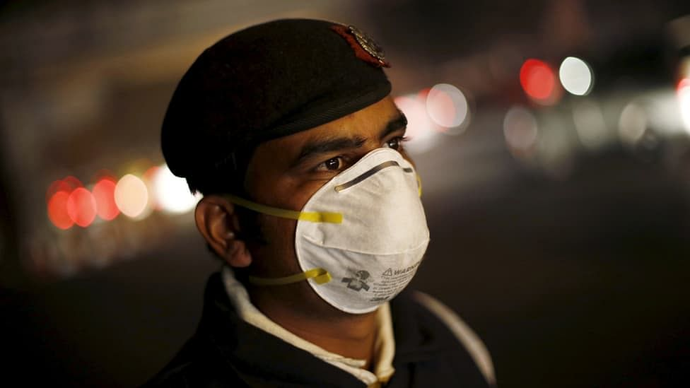 A file photo of a traffic policeman wearing a mask to protect himself from dust and air pollution in New Delhi.